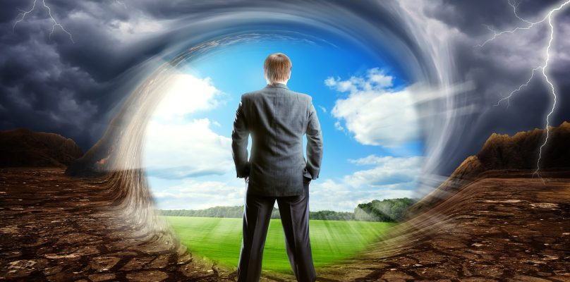 Businessman staying against cloudy clear sky, concept picture
